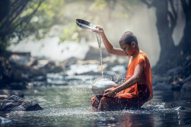 Young Buddhist meditating
